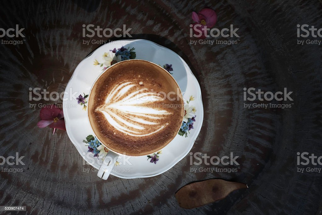 cup of hot cappuccino on the wood  background royalty-free stock photo