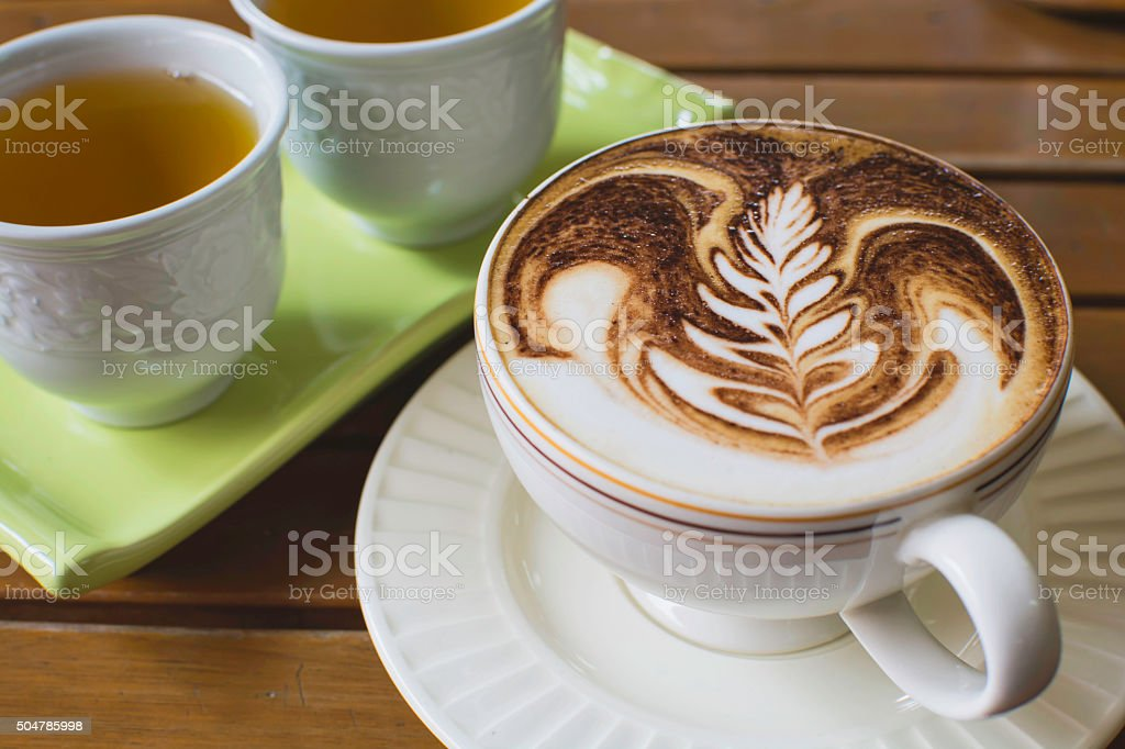cup of hot cappuccino over with hot tea royalty-free stock photo