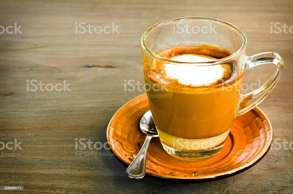 cup of hot caramel cappuccino coffee in cup stock photo