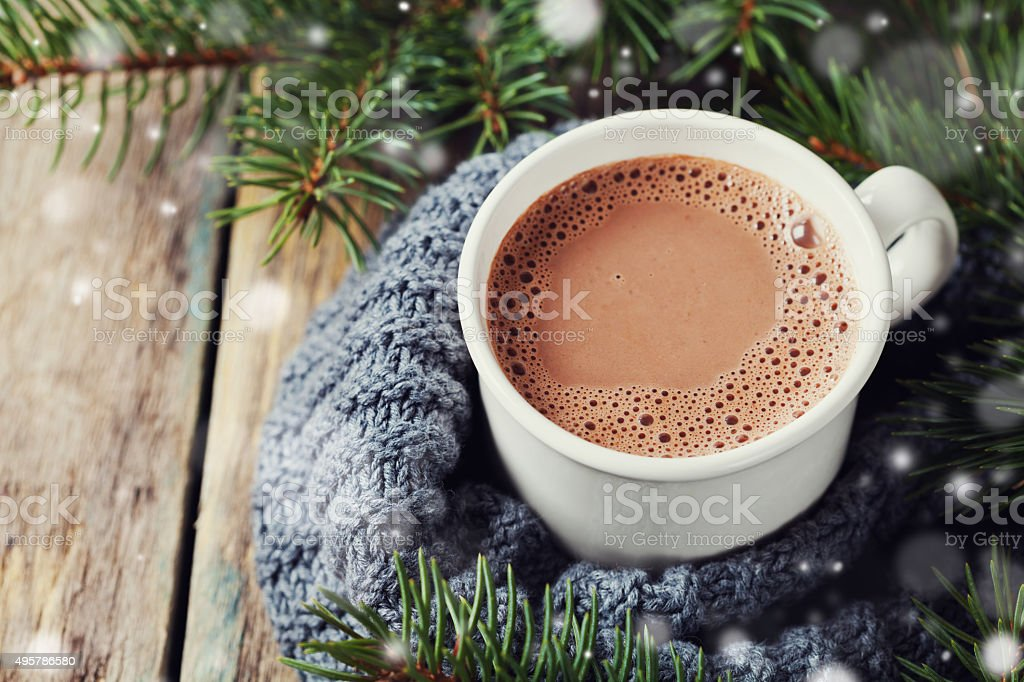 Cup of hot cocoa or hot chocolate with snow effect stock photo