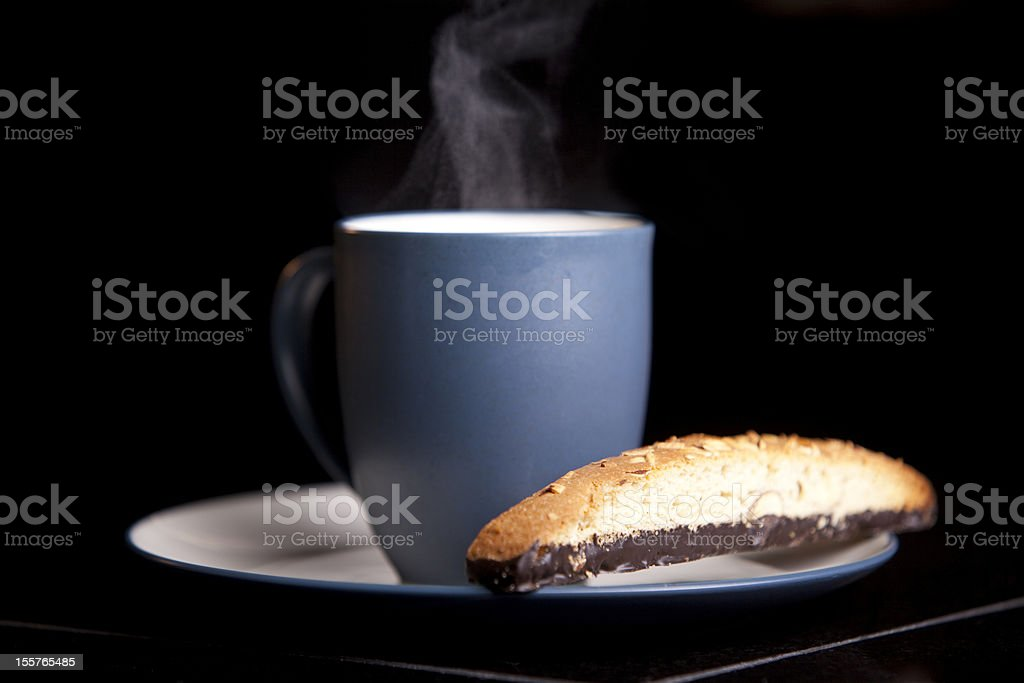 Cup of Hot Coffee and Biscotti royalty-free stock photo