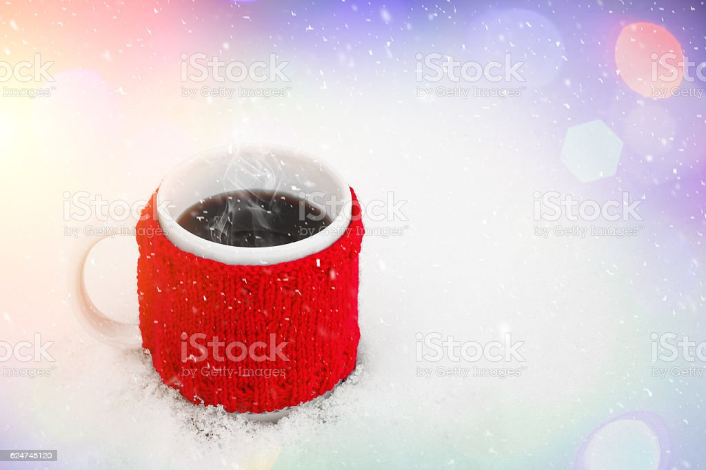 Cup of hot coffee on the snow stock photo