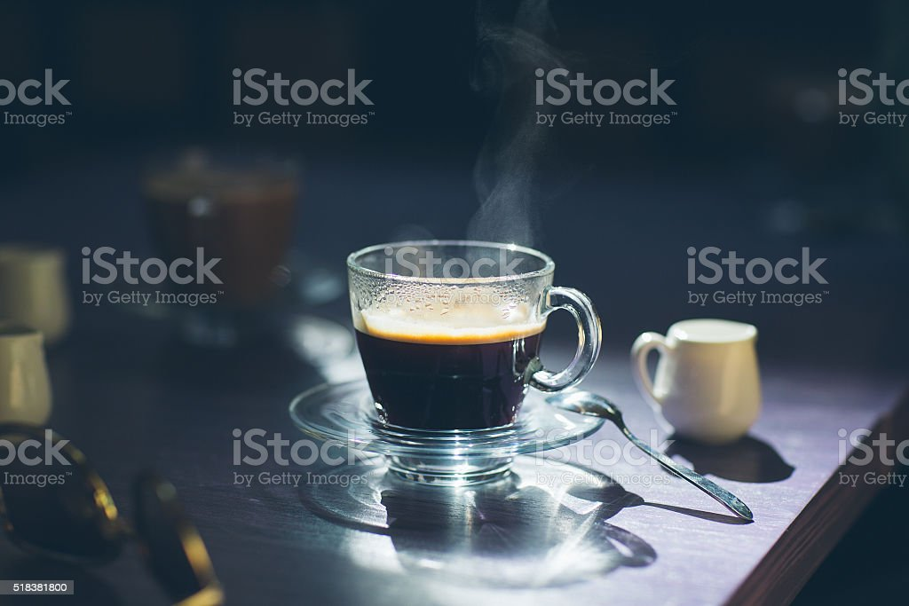 cup of hot coffee on the table stock photo