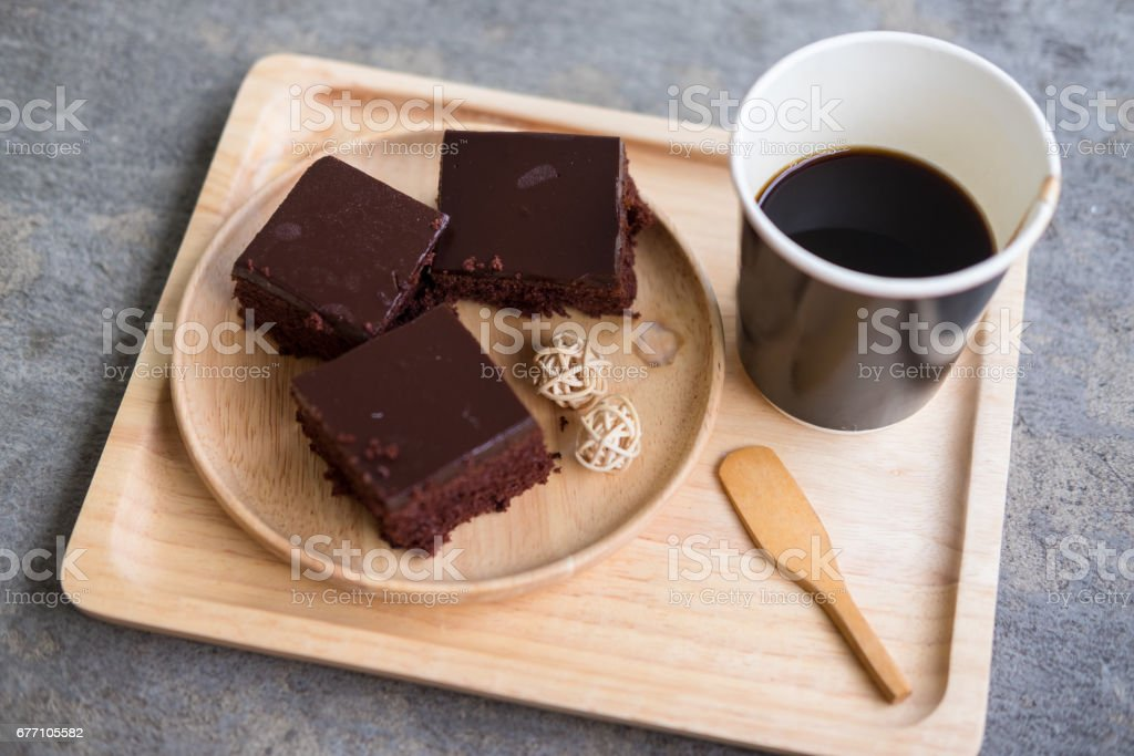 Cup of hot coffee with cake on wood tray stock photo