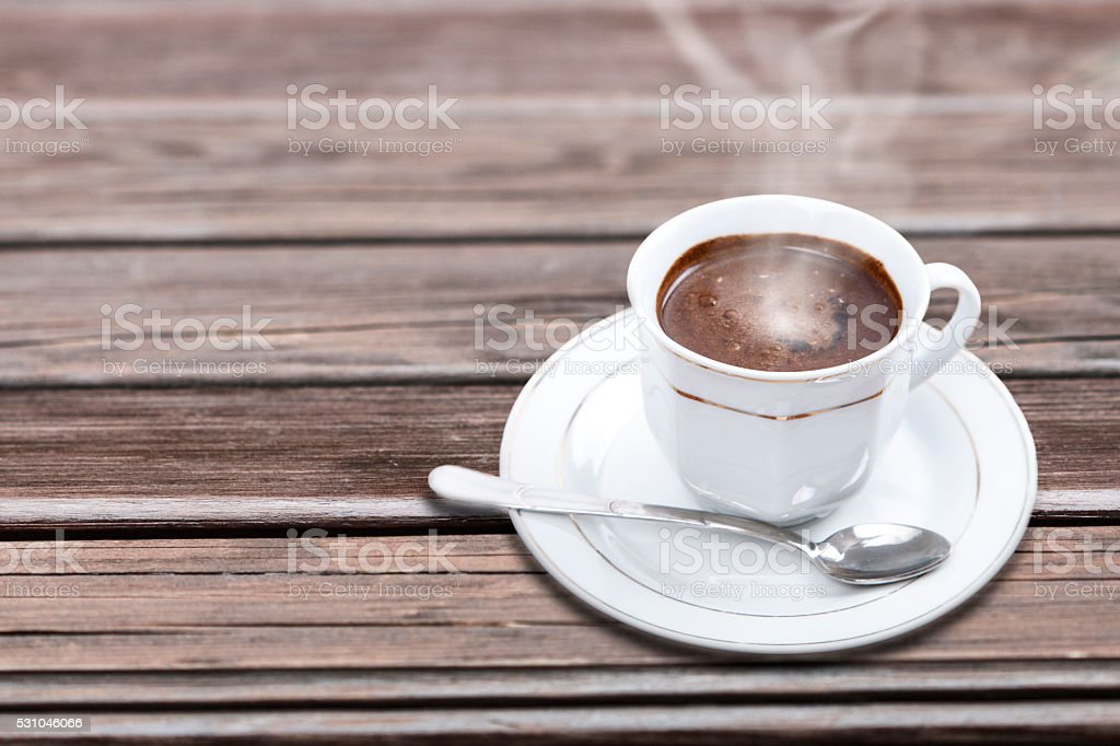 Cup of hot frothy coffee stock photo