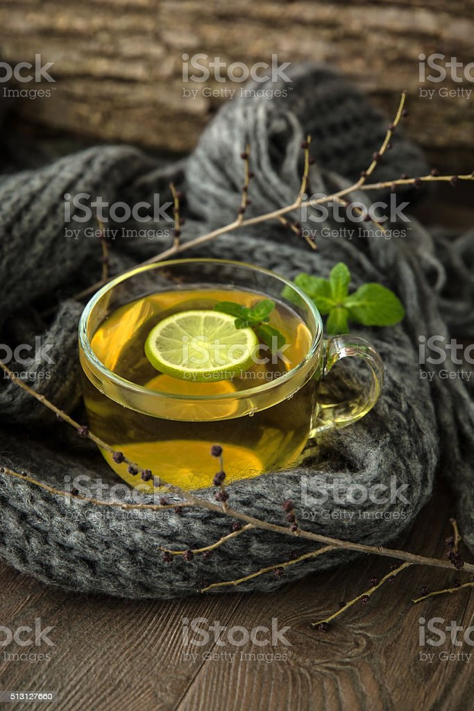Cup of hot green tea with lime stock photo