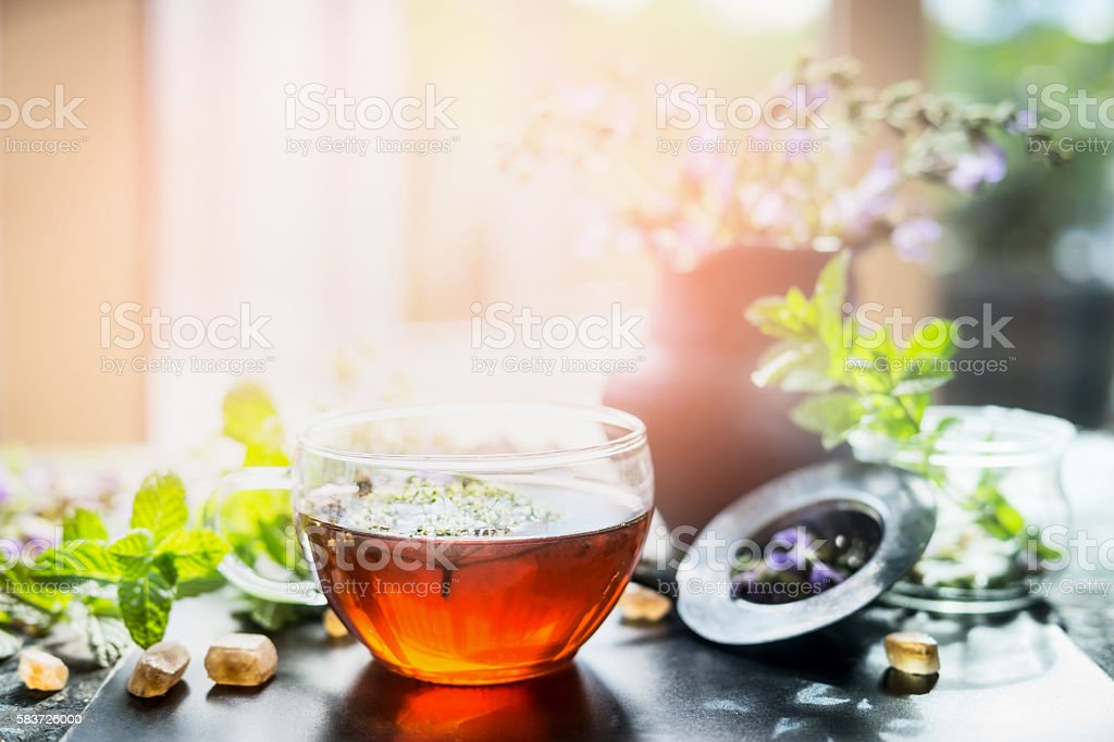 Cup of hot herbal tea on window still stock photo