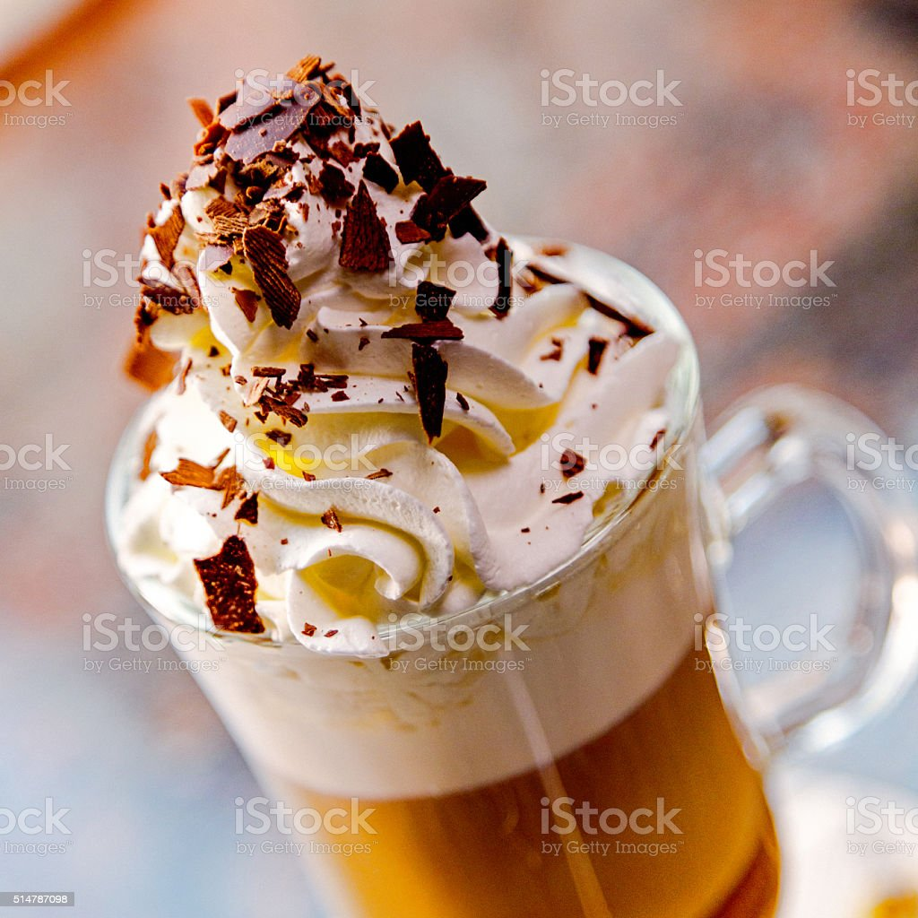 Cup of hot latte art coffee on merable table stock photo