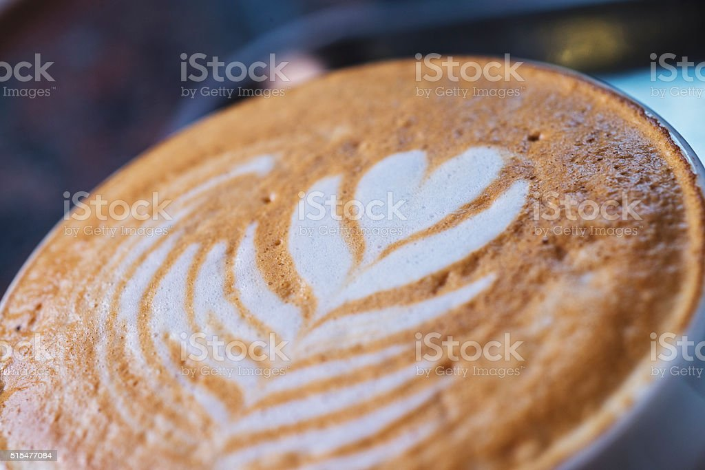 Cup of hot latte art coffee on the marble table stock photo