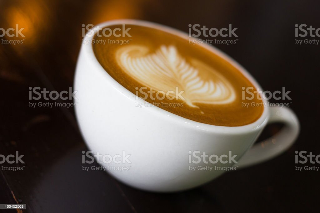 Cup of hot latte art coffee. stock photo
