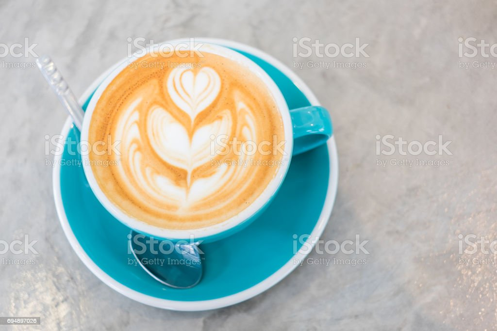 Cup of hot latte art coffee stock photo