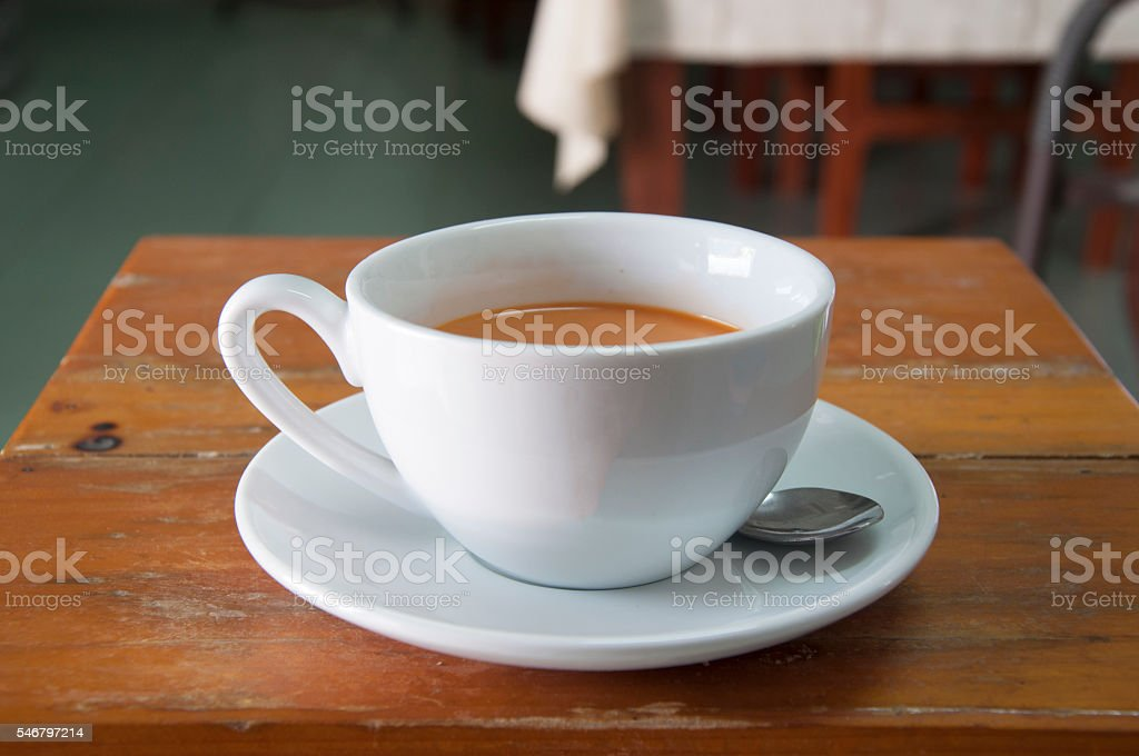 Cup of hot tea milk. coffee stock photo
