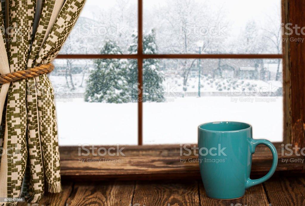 Cup of hot tea  on vintage windowsill stock photo