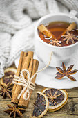 Cup of hot tea with lemon, a cinnamon stick