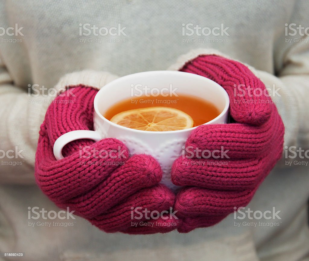 Cup of hot tea with lemon stock photo