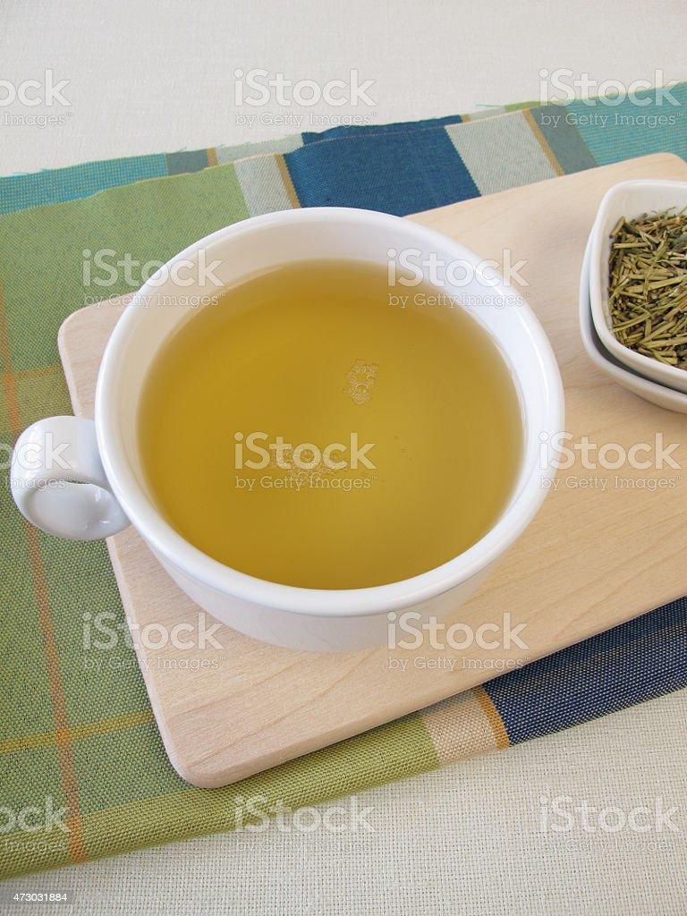 Cup of kukicha green tea stock photo