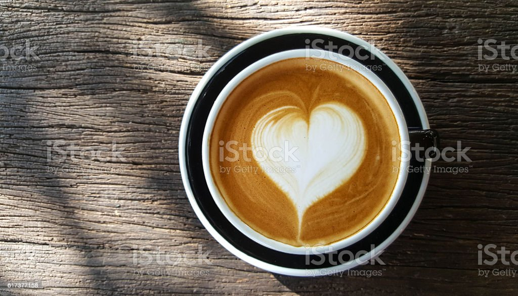 Cup of Latte art  on old wooden background,top view stock photo