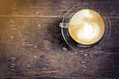 cup of latte coffee on wood table