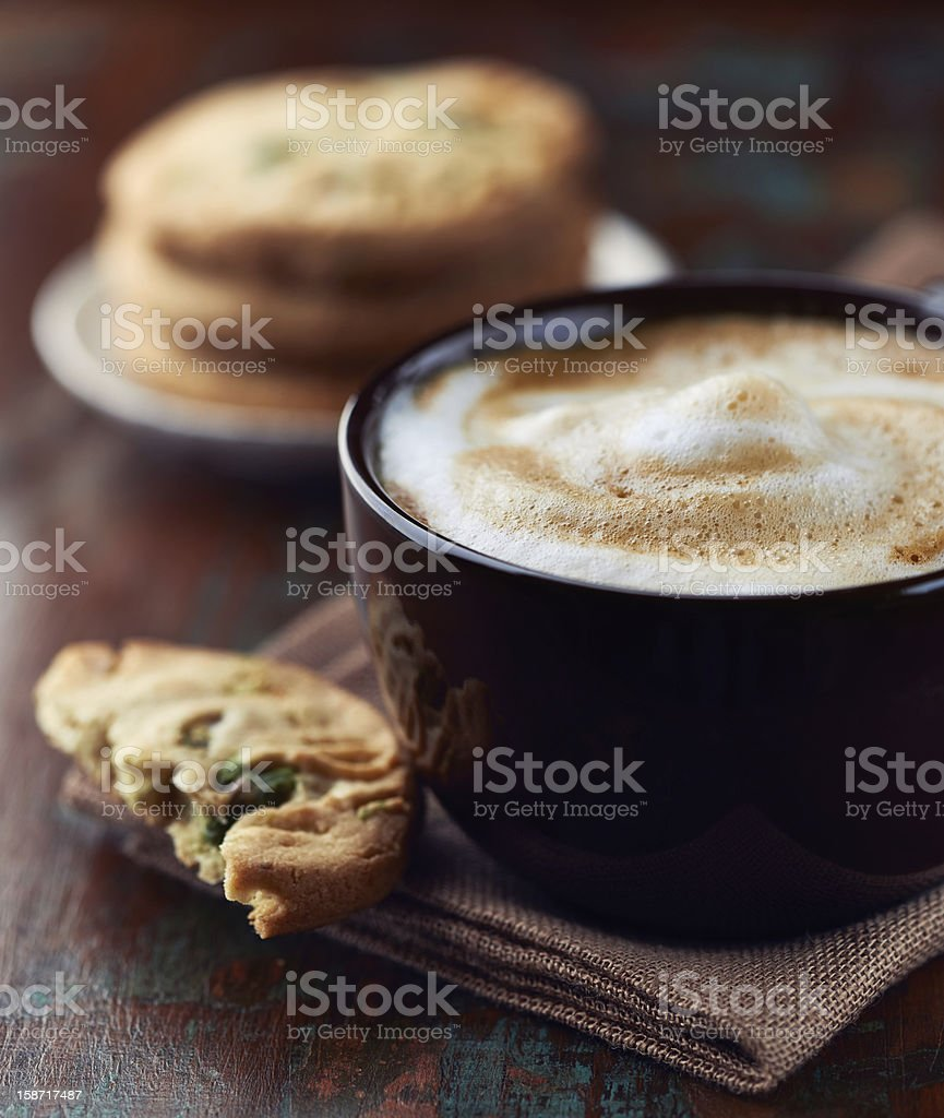 Cup of Latte Coffee with Pistachio Cookies royalty-free stock photo