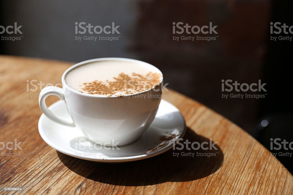 Cup of  latte in the table stock photo