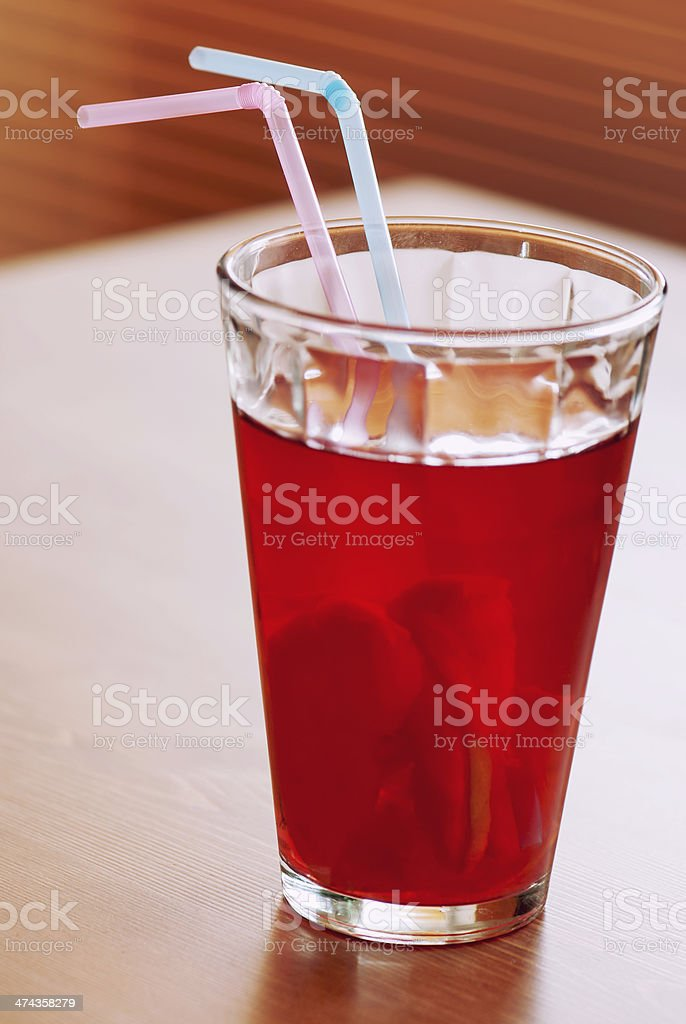 Cup of lemonade with two colored straws stock photo