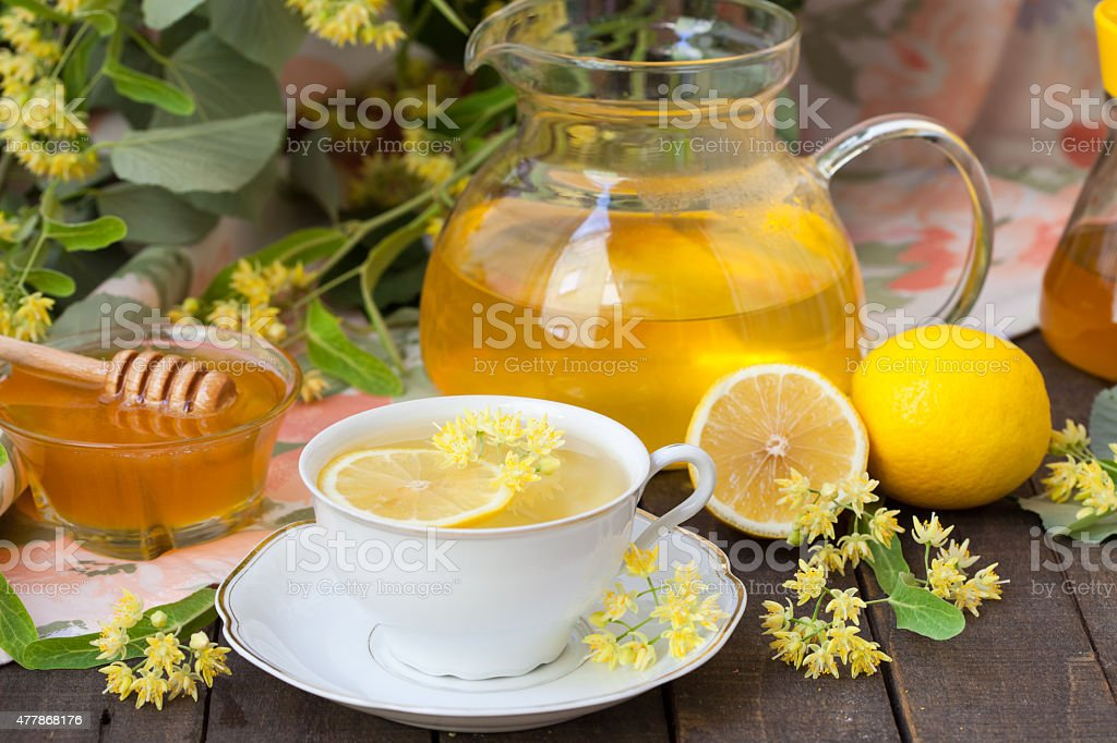 Cup of linden tea with lemon stock photo