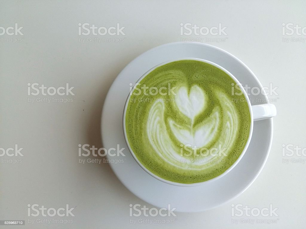 Cup of matcha latte isolated on white background stock photo