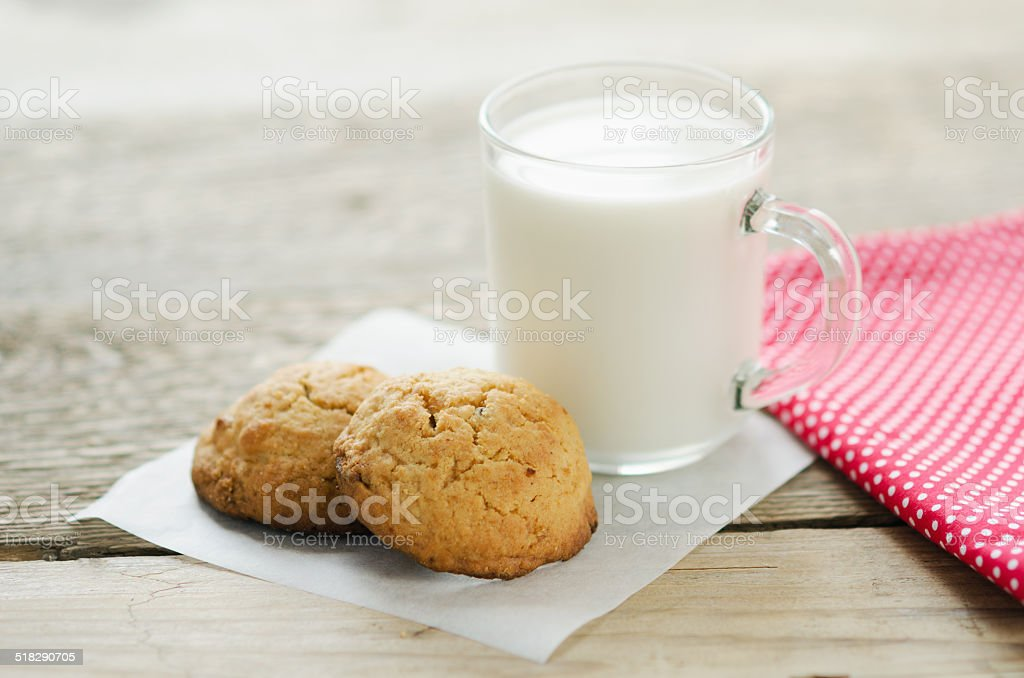 cup of milk with oatmeal cookies stock photo
