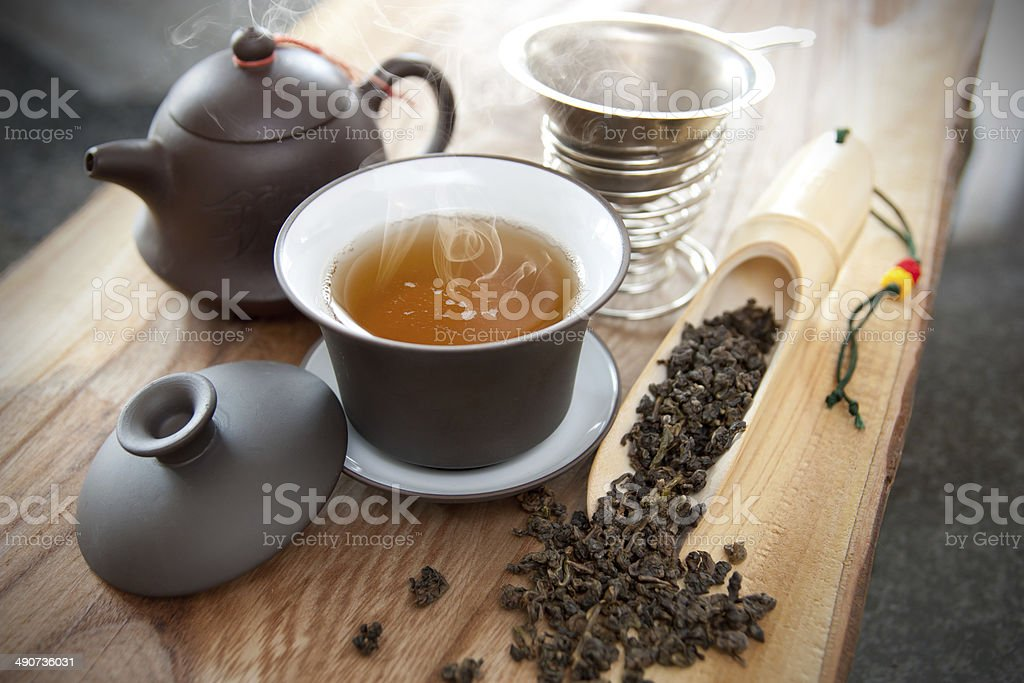 Cup of oolong tea and accessories stock photo