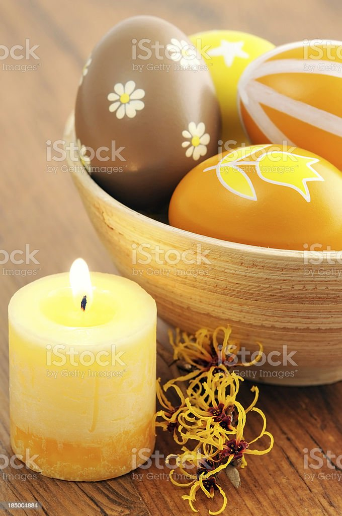 cup of ornate Easter egg with burning candle and Witchhazle stock photo