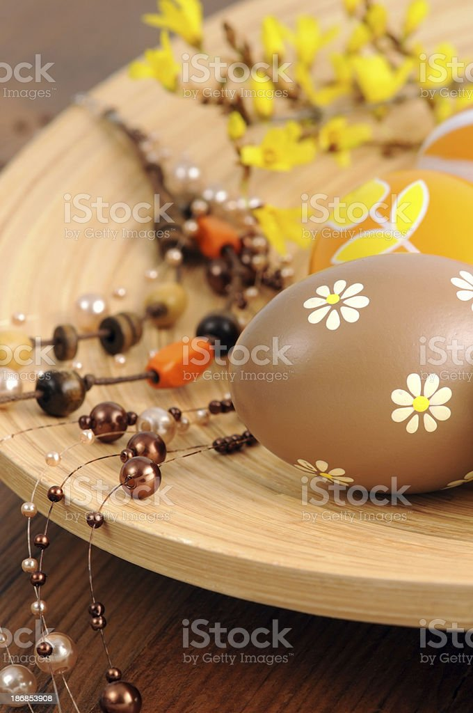 cup of ornate Easter egg with Forsythia and pearl necklace royalty-free stock photo