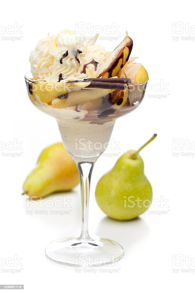cup of pear ice cream decorated with fruits stock photo