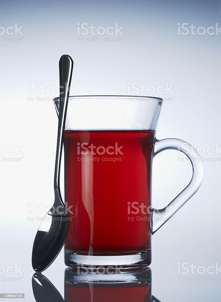 Cup of red fruit tea royalty-free stock photo
