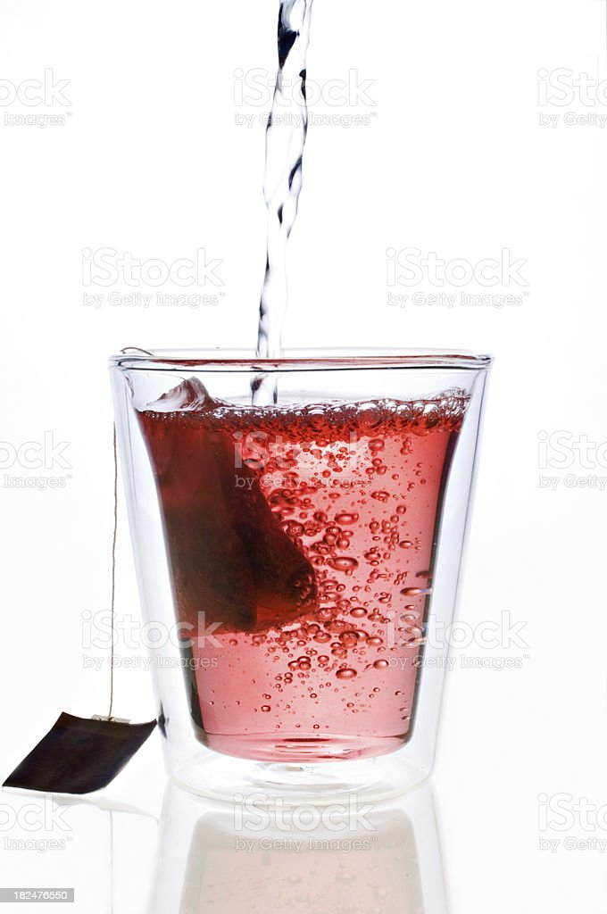 Cup Of Rosehip Herbal Tea Side On View White Background royalty-free stock photo