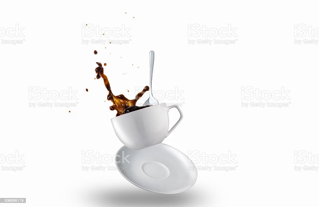 Cup of Spilling black Coffee Creating a Splash stock photo