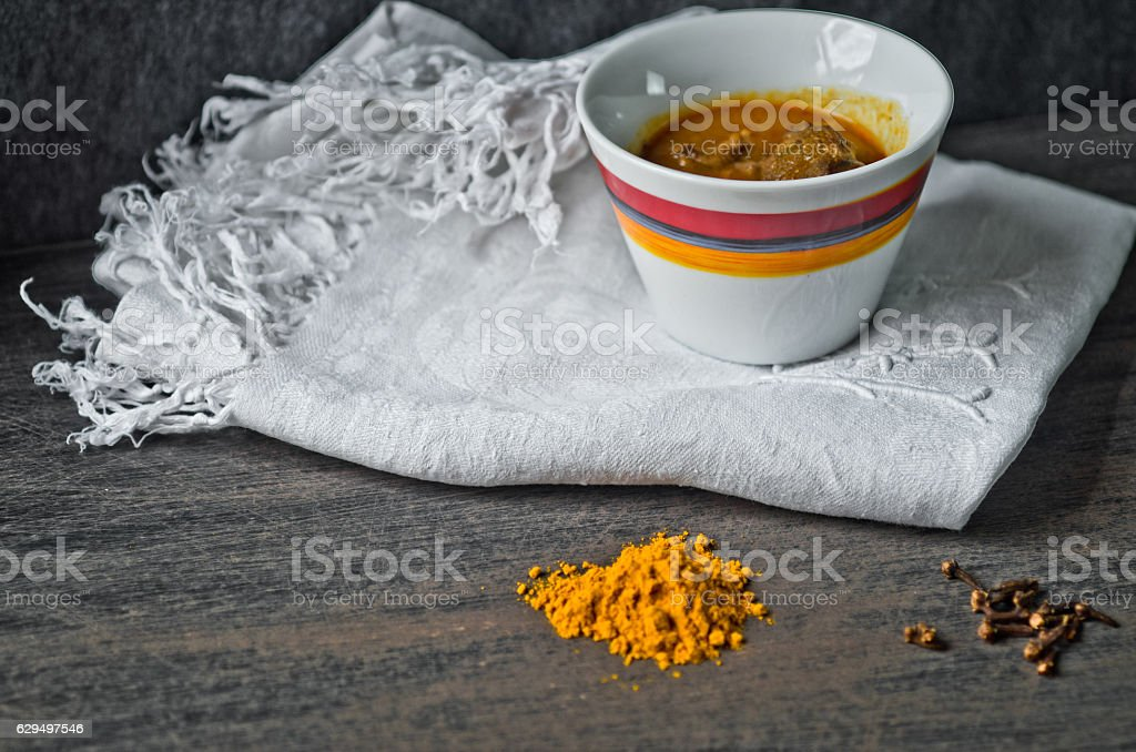 cup of steaming hot soup with spices on cotton embroidered stock photo
