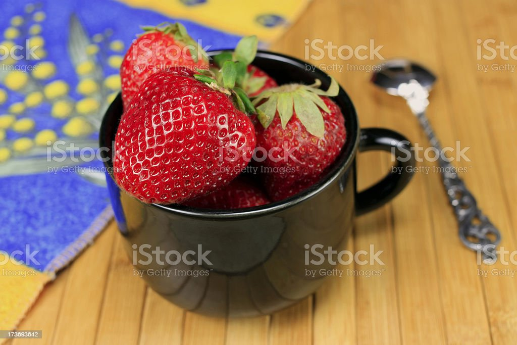 Cup of Strawberries with Spoon stock photo