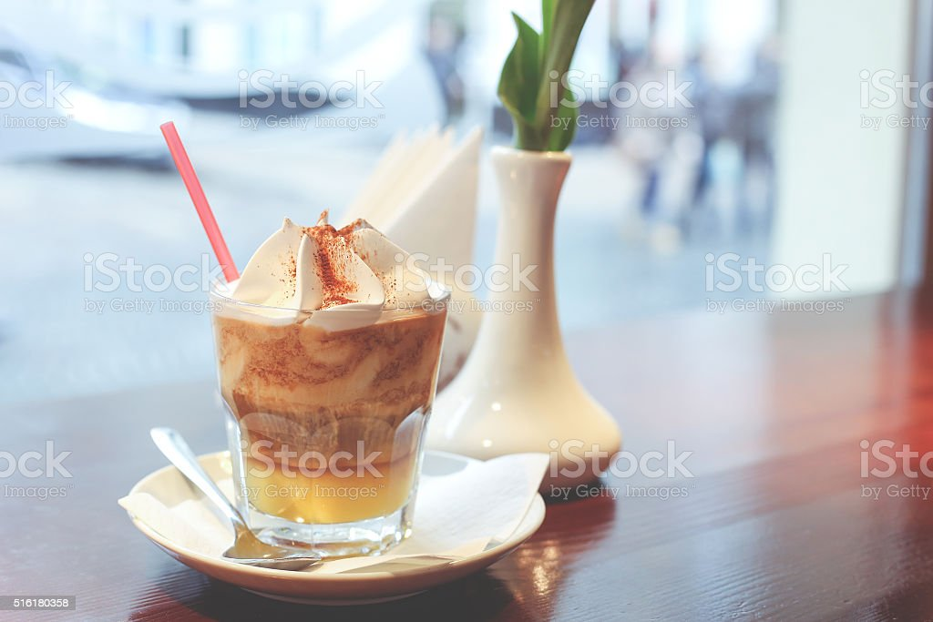 Cup of tasty creamy frappuccino stock photo