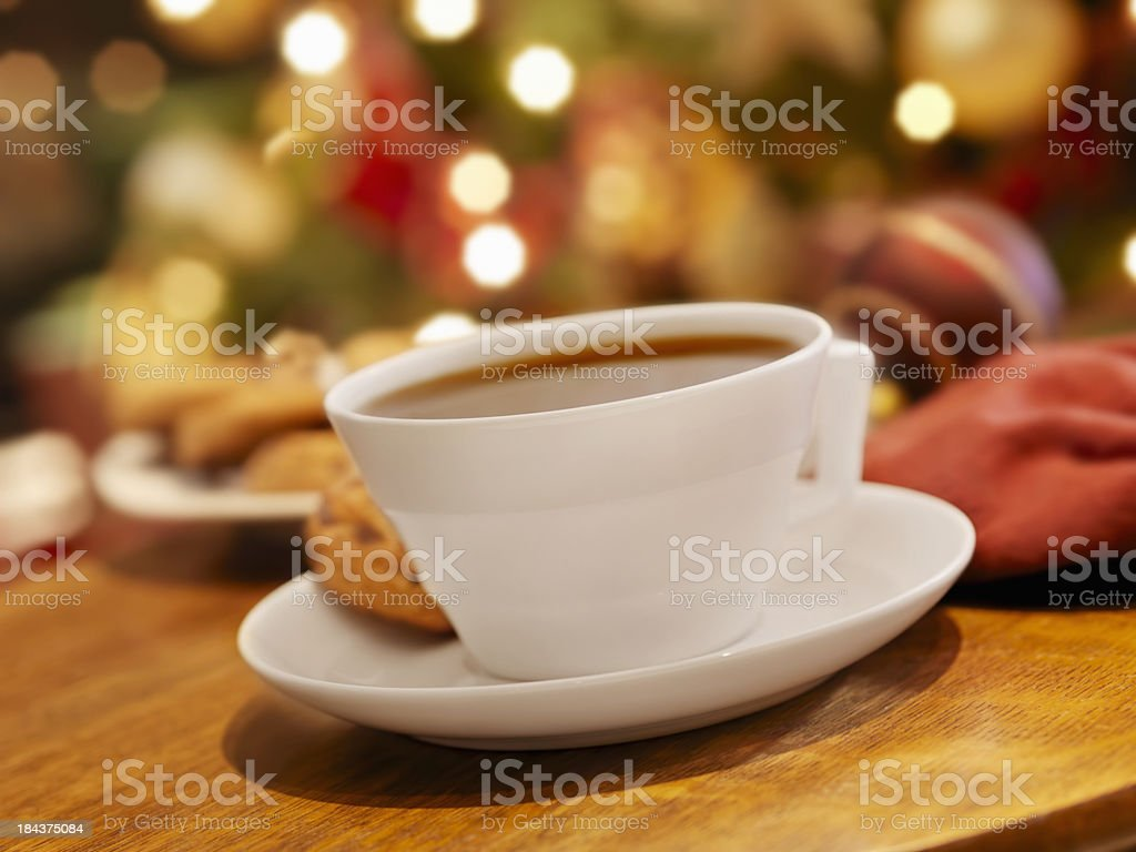 Cup of Tea and a Cookie at Christmas Time royalty-free stock photo