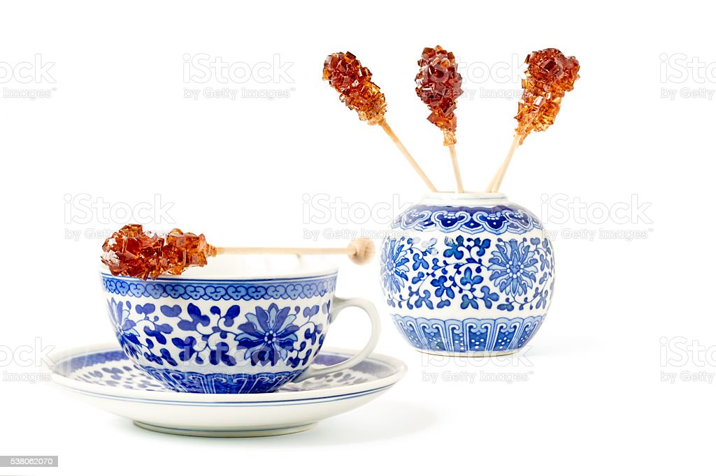 Cup of Tea and Brown Sugar Stirrers stock photo