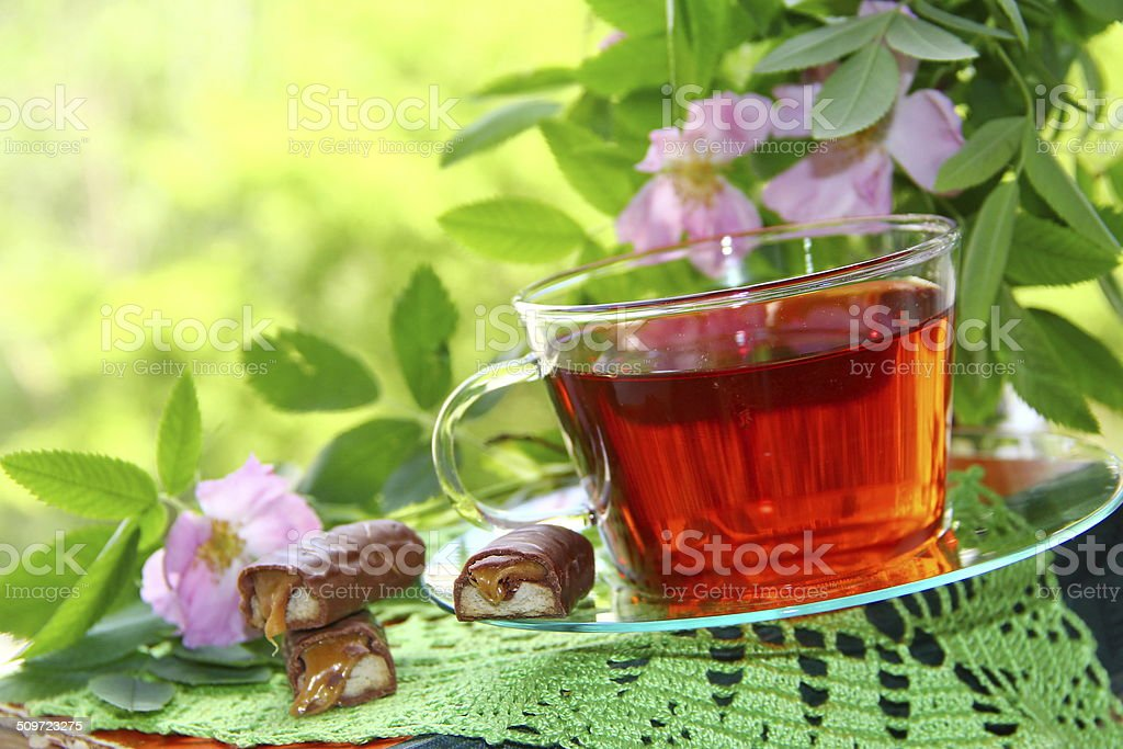 Cup of tea and candeis stock photo
