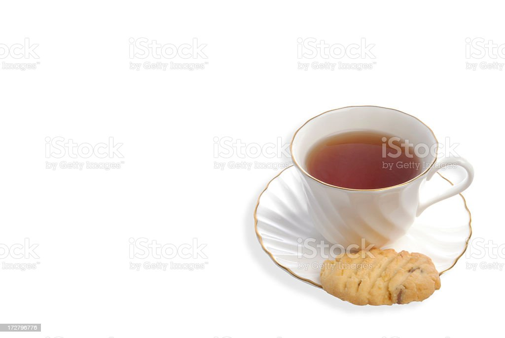 Cup of tea and chocolate chip cookie on white background royalty-free stock photo