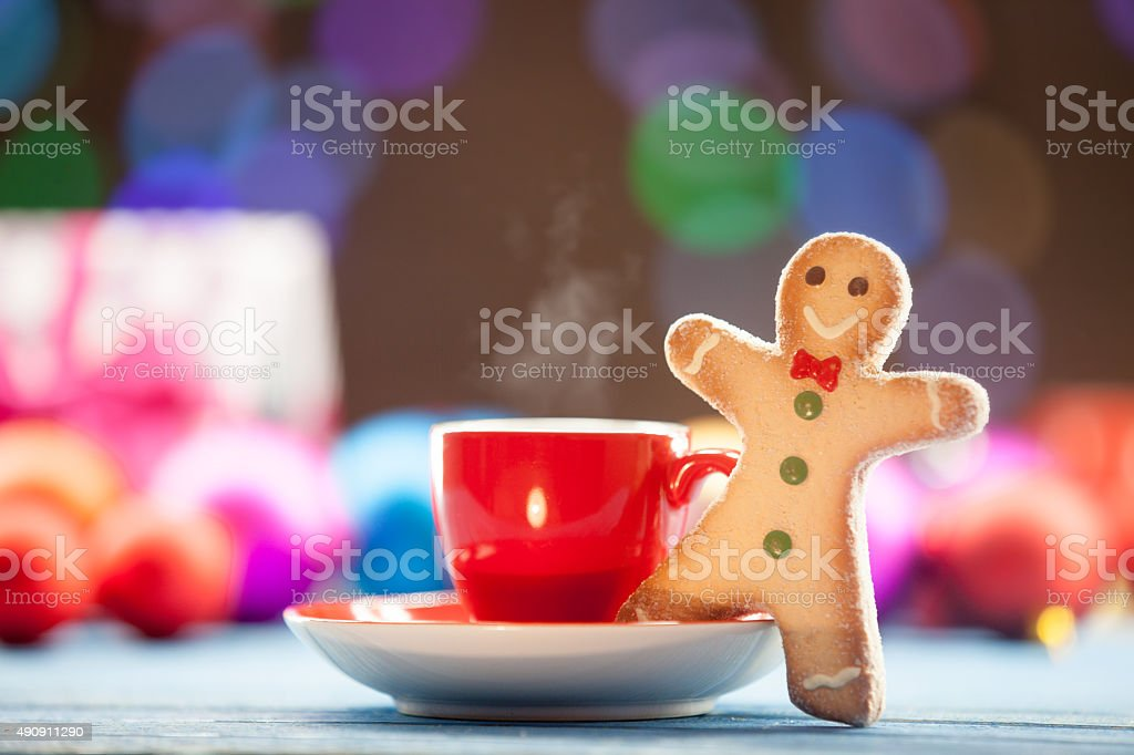 Cup of tea and cookie with Christmas lights stock photo