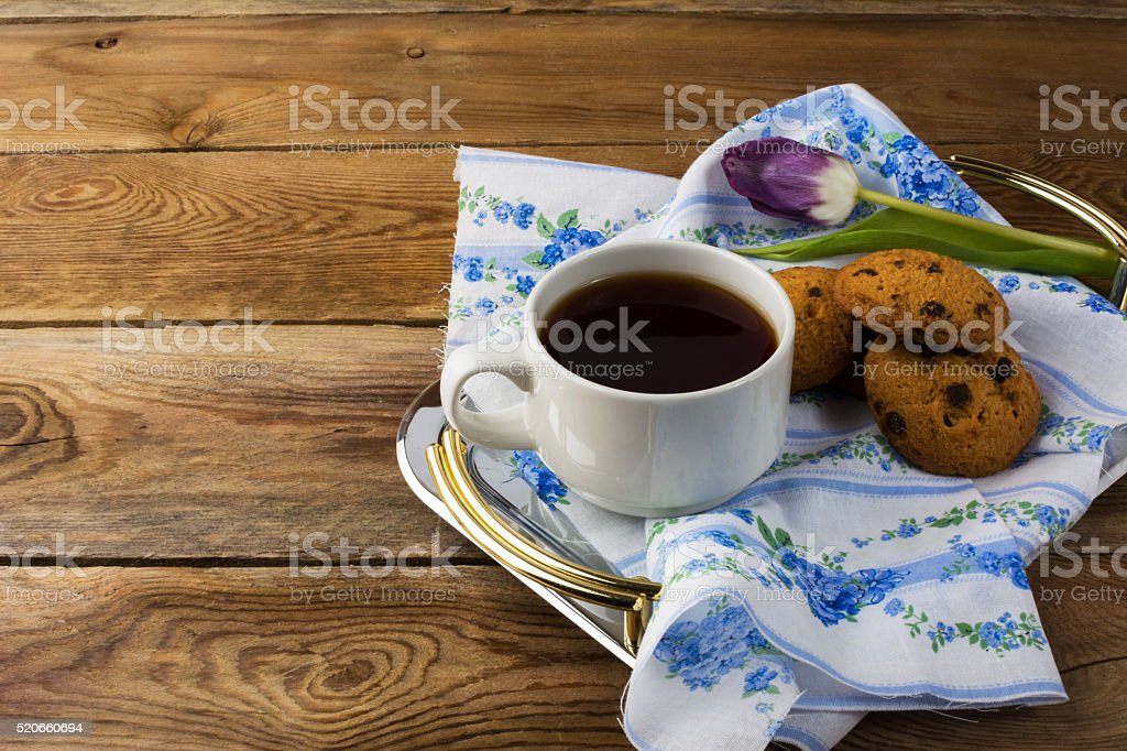 Cup of tea and cookies on tea tray stock photo