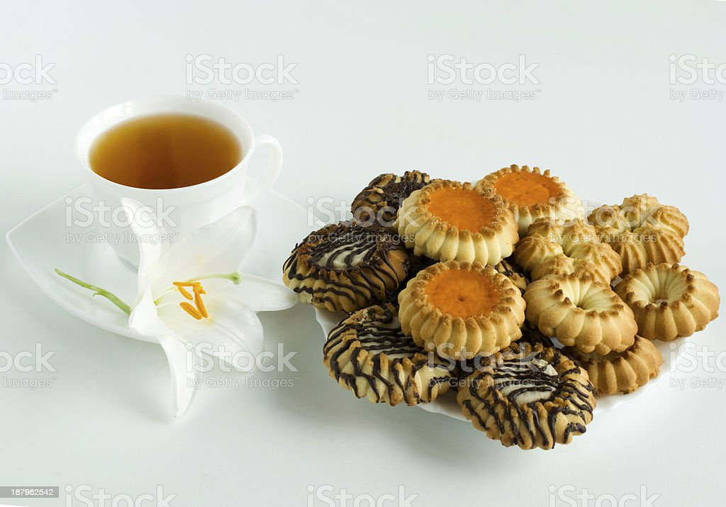cup of tea and cookies stock photo