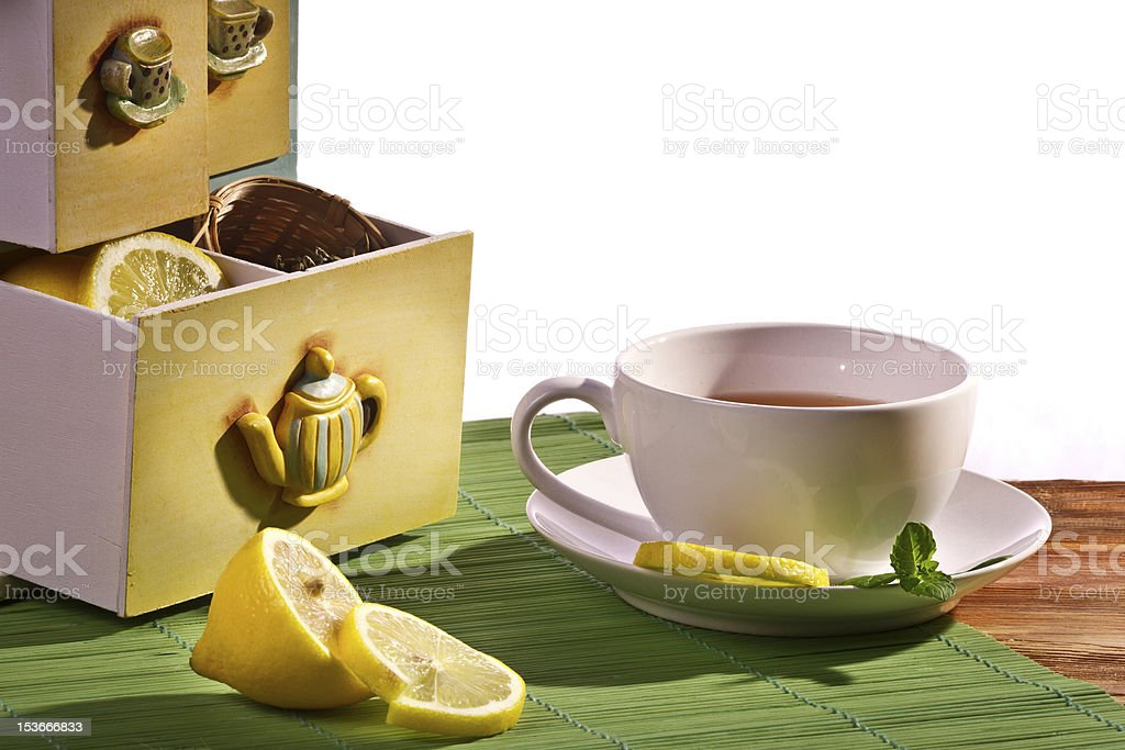 Cup of tea and Cupboard with lemon royalty-free stock photo