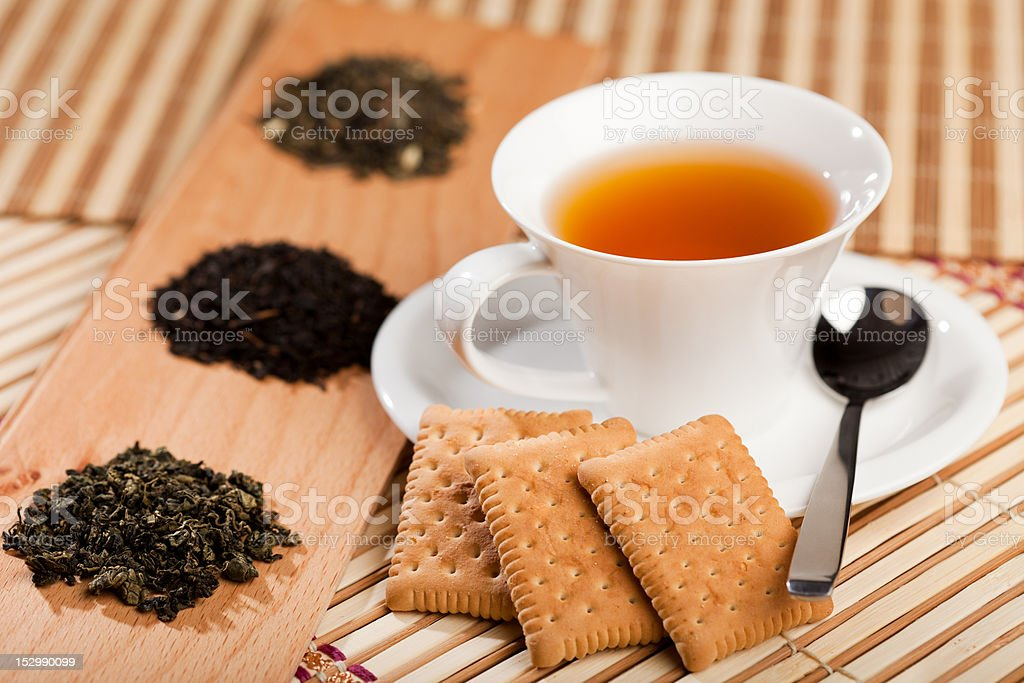 Cup of tea and dried leaves stock photo