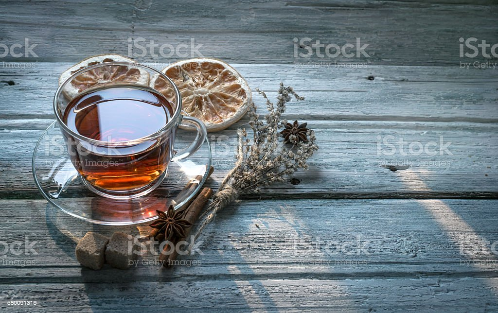 Cup of tea and dry twig herb stock photo