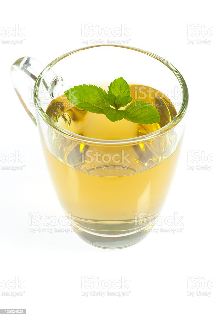 Cup of tea and mint leaves royalty-free stock photo