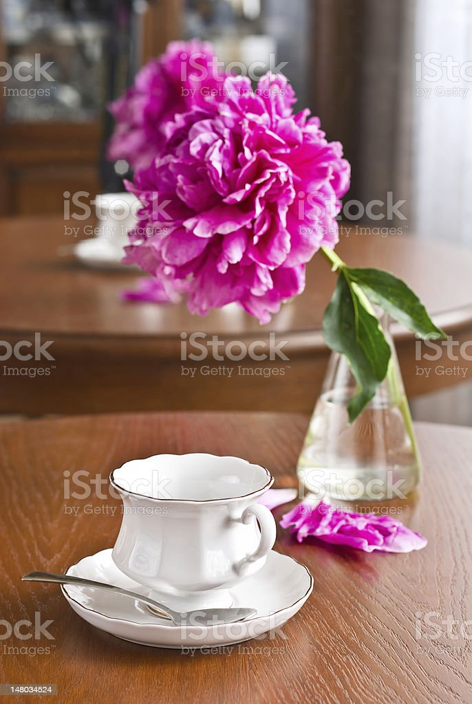 Cup of tea and peony royalty-free stock photo